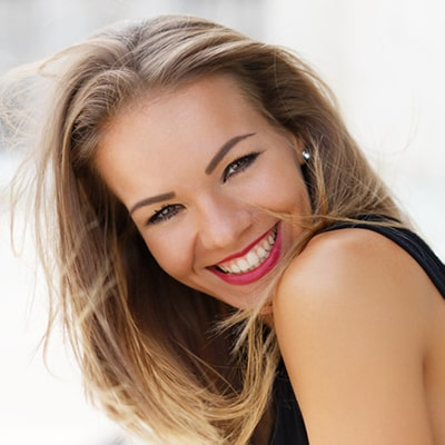 Young blonde female with great teeth smiling
