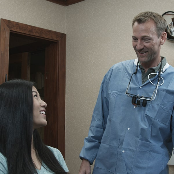 Dr. Godwin discussing porcelain veneers with a patient in Simpsonville